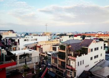 Image of rooftops in an urban neighborhood.