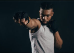 Photo of a professional boxer with one fist extended.