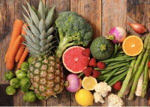 Image of many fruits and vegetables: pineapple, grapefruit, broccoli, carrots, and more.