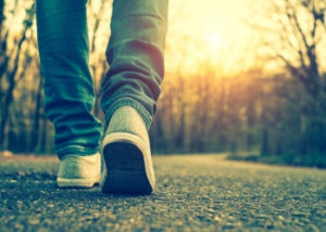image of someone's feet walking down the road