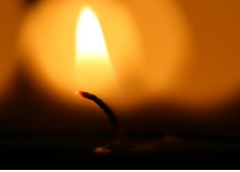 Close-up of a candle flame in the darkness.