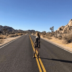 Best Things About 2018. Bryn Donovan, wearing cowboy boots, in Joshua Tree National Park